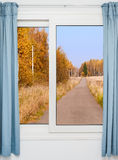 View from the window on the road and autumn landscape Stock Images