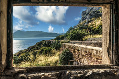 View from a window of the ruins of the lighthouse of Capo Zaffer Stock Image
