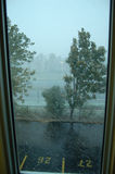 View from a window during a snow storm royalty free stock images