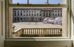 View from a window in Somerset House. SOMERSET HOUSE, LONDON, UK - APRIL 22nd 2018: View looking out of a sash window at Somerset House. Shows pollution pods stock photography