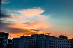 The view from the window at sunset in an autumn evening. Orange sunset. Unfinished building Stock Photography