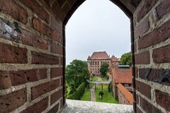 View through window to old castle in Malbork Royalty Free Stock Photography
