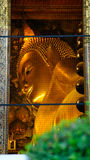 View on window to Reclining Buddha gold statue in hall Royalty Free Stock Photo