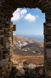 View from window to sea and mountain. Cyclades, Tinos island, Greece Royalty Free Stock Photography