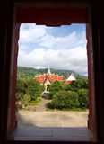 View from the window to Thai Buddhist temple Royalty Free Stock Image