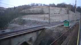 View from a window of a train moving stock video footage