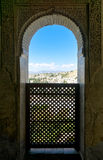 View through a window in the world-famous Alhambra. In Granada with beautiful views of the fortress and Granada stock photo