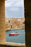 The view through the windows watchtower in Senglea. View of Valletta inside of watch tower at Gardjola Gardens, Fort San Michael, Senglea on the Malta island Royalty Free Stock Image