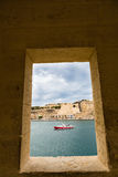 The view through the windows watchtower in Senglea. View of Valletta inside of watch tower at Gardjola Gardens, Fort San Michael, Senglea on the Malta island Stock Photos