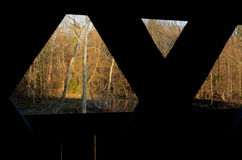 View from windows of wooden covered bridge on rural road Royalty Free Stock Photography
