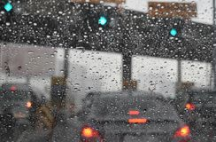 View through the windshield on the road checkpoint motorway in the rainy season. Car trouble in the big city royalty free stock photo