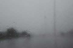 View through the windshield on the road in the rainy season. Stock Image