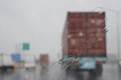 View through the windshield on the road in the rainy season. Stock Photos