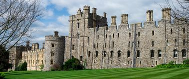 View of Windsor Castle walls and tower with arched windows, England