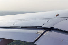 View of the wing of the aircraft from the window Stock Images