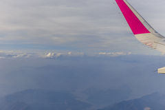 View of the wing of the aircraft from the window Royalty Free Stock Photo