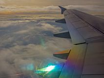 The wing of an airplane and the clouds royalty free stock photo