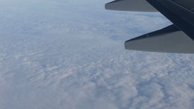 View of the wing of an airplane in flight over beautiful air clouds. A view of the wing of an airplane in flight over beautiful air clouds stock video
