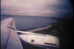 View from wing of airplane on runway stock footage
