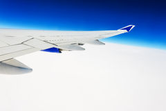 View of the wing of an airplane through the window Royalty Free Stock Image