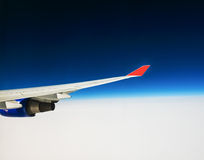 View of the wing of an airplane through the window Royalty Free Stock Photography