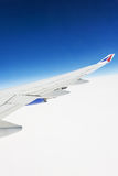 View of the wing of an airplane through the window Stock Photography