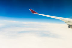 View of the wing of an airplane through the window Royalty Free Stock Photo