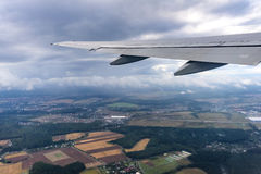 View of the wing of an airplane through the window Stock Image