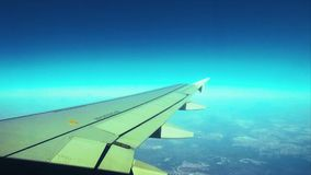 View of the wing of an airplane through the window stock video footage