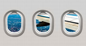 View of wing and big city from airplane windows. Flight concept stock illustration