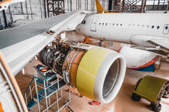 View of the wing and engine of the aircraft repair in the hangar. Stock Photo