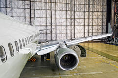View of the wing and engine of the aircraft repair in the hangar. Royalty Free Stock Images