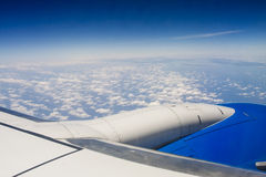 View of Wing Engine and Clouds at Altitude Royalty Free Stock Images