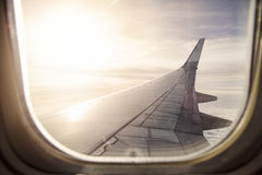 View of wing from flying airplane. Wing of commercial airplane flying in the sky royalty free stock images