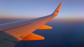View of the wing at sunset stock video
