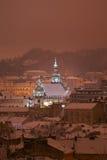 View of the winter night city center. Evening city. Lviv, Ukraine. View of the central part of the city and church: Evening lighting Bernardine church Royalty Free Stock Photo