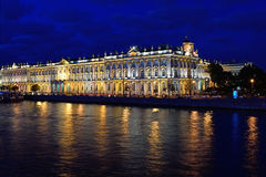 View of the Winter Palace from the Palace bridge on Neva river during the white nights in St. Petersburg. Royalty Free Stock Photography