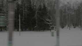 View of winter park from moving train stock footage