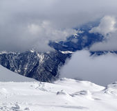 View on winter snowy mountains in clouds Royalty Free Stock Image