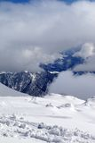 View on winter snowy mountains in clouds Stock Photo