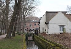 View of the Woluwe River and the old Lindekemale Watermill stock photography
