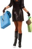 View of woman carrying shopping bag. Waist-down view of woman carrying shopping bag Stock Photos