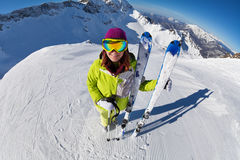 View of woman in mask standing and holding ski. And ski poles during sunny winter day on Krasnaya polyana ski resort and Caucasus mountains in Sochi, Russia Stock Images