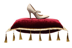 A view of a woman's shoe on a pillow stock image