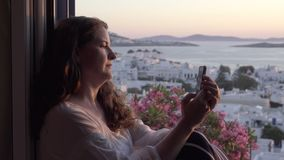 Woman uses cell phone technology on vacation. View of a woman using cell phone technology on vacation stock video