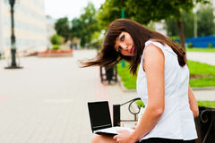 View women. A woman bending over sitting on the bench Royalty Free Stock Photos