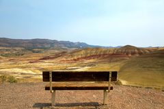 Bench View at Painted Hills Overlook in eastern Oregon. View from the wood bench at Painted Hills Overlook in Eastern Oregon on a sunny day stock photos
