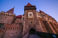 View from the wood bridge of Corvinilor Castle. In the evening light in Hunedoara city, Hunedoara County, Romania Royalty Free Stock Images
