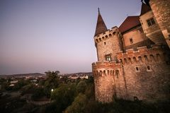 View from the wood bridge of Corvinilor Castle. In the evening light in Hunedoara city, Hunedoara County, Romania Stock Photography