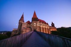 View from the wood bridge of Corvinilor Castle. In the evening light in Hunedoara city, Hunedoara County, Romania Royalty Free Stock Image